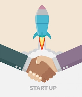 Een handdruk deal business start-up concept.