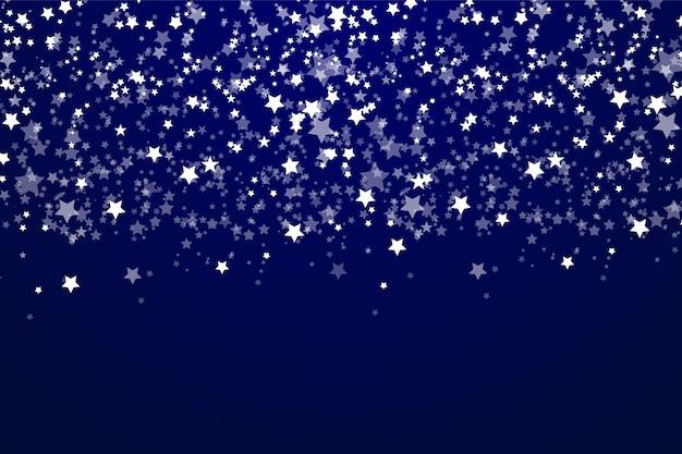 Een heldere ster aan de blauwe donkere nachthemel.