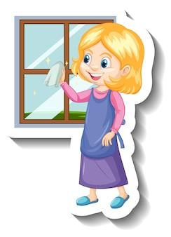 Een huishoudster die de sticker van het stripfiguur van het raam schoonmaakt