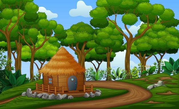 Een huisje in het midden van het bos