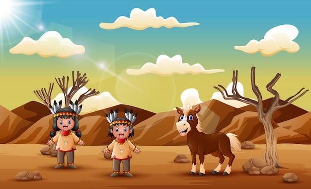 Een indisch paar met paard in de droge woestijn