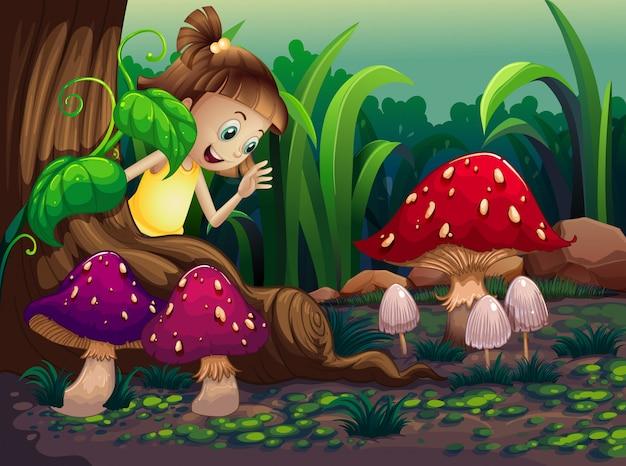 Een jong meisje in de buurt van de wortels van de gigantische boom