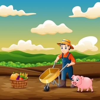 Een jonge boer die op de landbouwgrond werkt