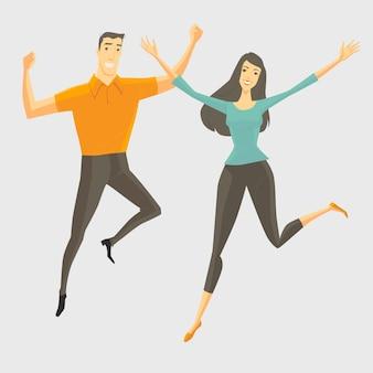 Een jonge man en een jonge vrouw springen, glimlachen en gelukkig.