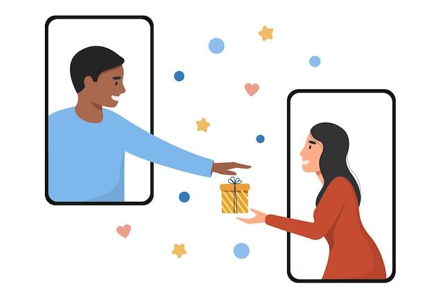 Een jonge man en een vrouw steken hun hand uit naar het geschenk via het telefoonscherm