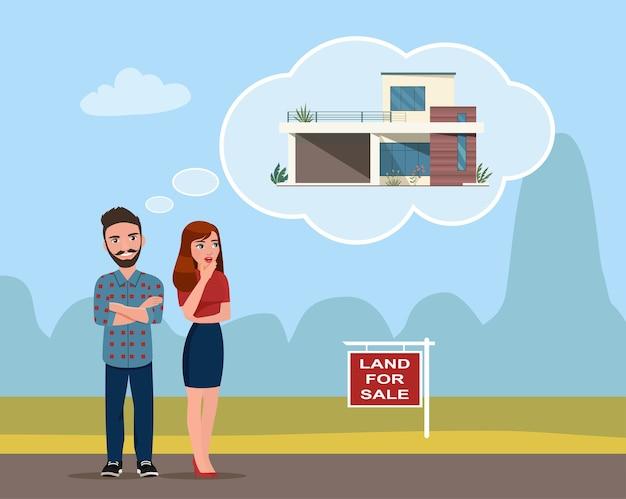 Een jonge man en vrouw kiezen een stuk land om een huis te bouwen.