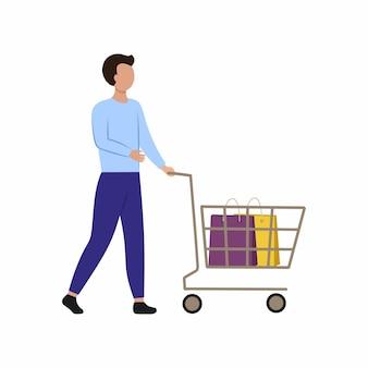 Een jonge man met een winkelwagentje gaat naar de winkel. een man op de markt doet aankopen. vector plat karakter.