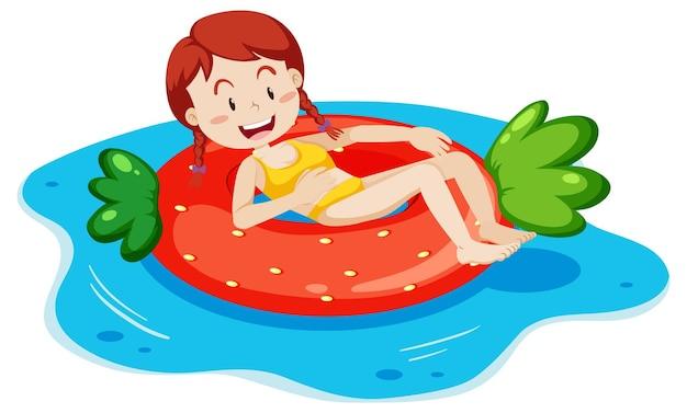Een jonge vrouw die op een geïsoleerde zwemring legt