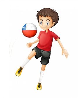Een jongen die de bal uit chili gebruikt