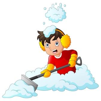 Een jongen die de opgehoopte sneeuwillustratie schoonmaakt