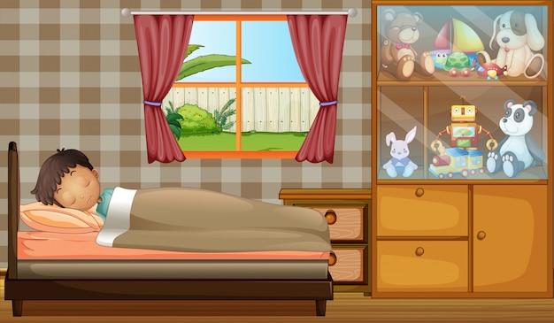 Een jongen die in zijn slaapkamer slaapt