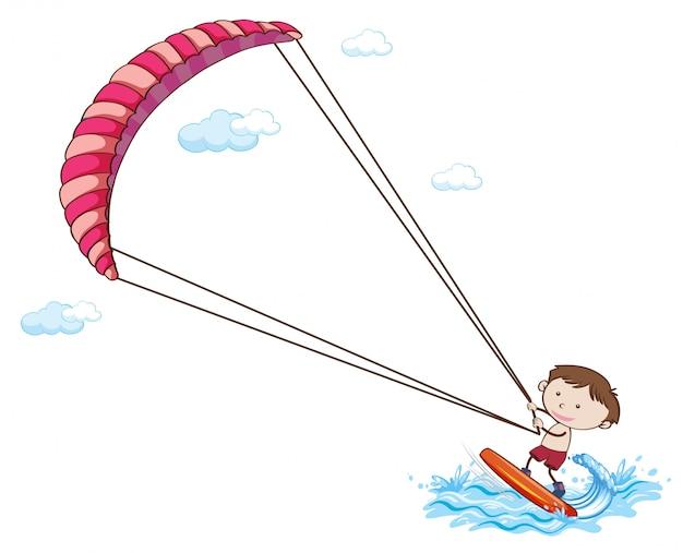 Een jongen die op witte achtergrond kitesurft