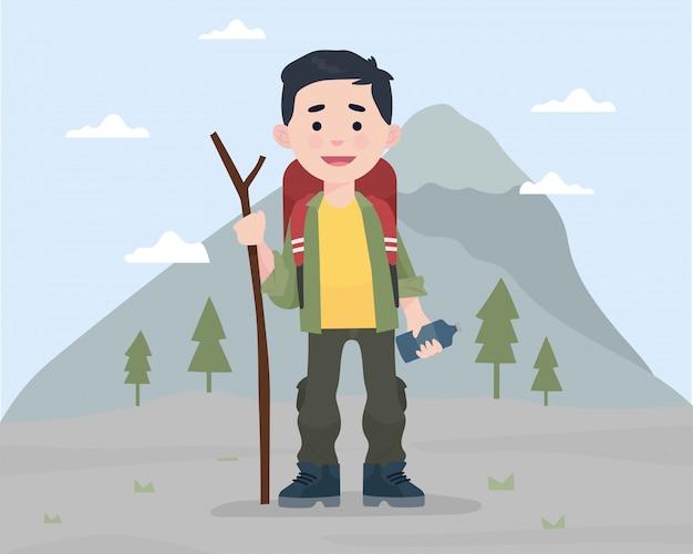 Een jongen die zich voor berg met montainentoestel bevindt