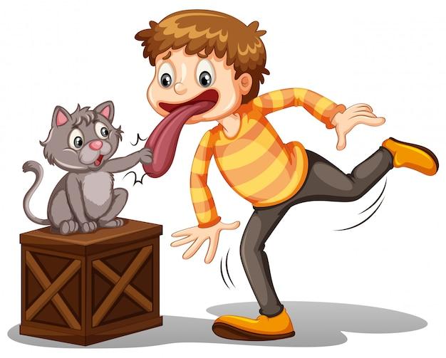 Een jongen en een kat