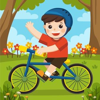 Een jongen in een helm met plezier in het voorjaarspark met zijn blauwe fiets op een mooie dag.