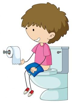 Een jongen in het toilet