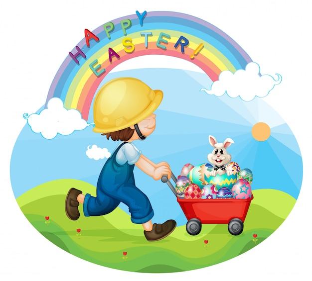 Een jongen met een helm die de eieren en het konijn duwt