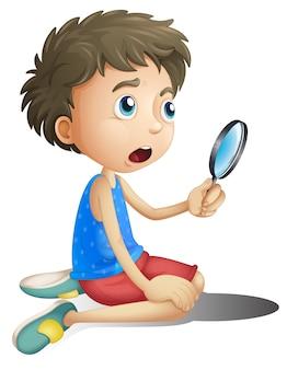 Een jongen met een vergrootglas