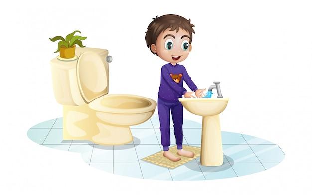 Een jongen wast zijn handen bij de gootsteen