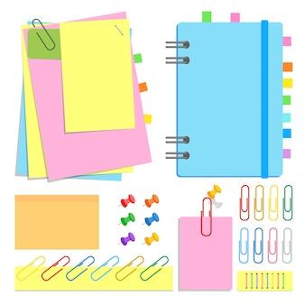 Een kanselarij. gesloten notitieboekje op een spiraal, plakvellen in verschillende vormen en kleuren, bladwijzers, spelden, clips, nietjes.