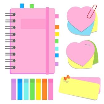 Een kanselarij. gesloten notitieboekje op een spiraal, zelfklevende vellen met verschillende vormen, tabbladen.