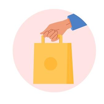 Een klant met ecologische boodschappentas. koerier uitgestrekte hand met ambachtelijke papieren zak. concept van bezorgvoedsel. cartoon geïsoleerd.
