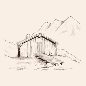 Een klein houten huis met een stenen pijp in de bergen.