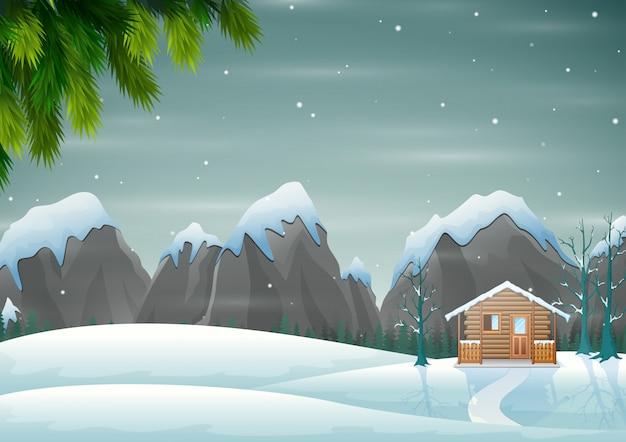 Een klein houten huis op de besneeuwde heuvel