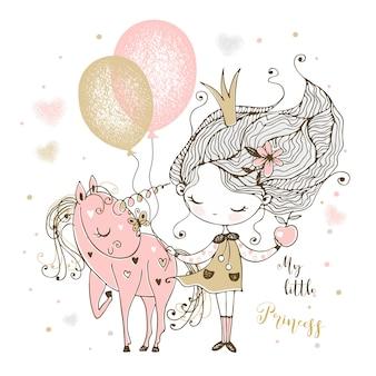 Een kleine schattige prinses met een eenhoorn en ballonnen.