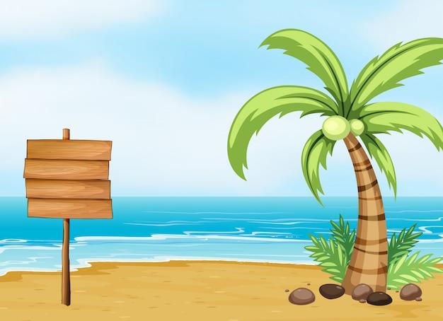 Een kokospalm en een leeg bord op het strand