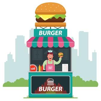 Een kraam op straat die hamburgers verkoopt tegen de achtergrond van de stad. verkoper die fastfood aanbiedt. vlakke afbeelding.
