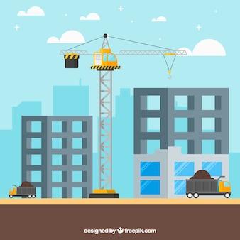 Een kraan op de bouw van twee gebouwen