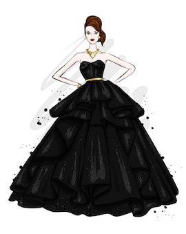 Een lang, slank meisje in een prachtige avondjurk. mode en stijl.