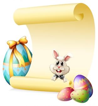 Een lege papieren sjabloon met een konijn en paaseieren