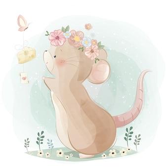 Een leuke muis die een vlinder achtervolgt
