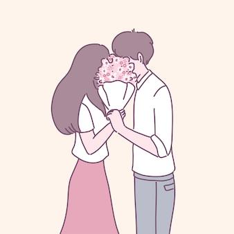 Een man die bloemen geeft aan de vrouw van wie hij houdt