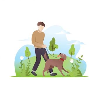 Een man die met zijn hond loopt