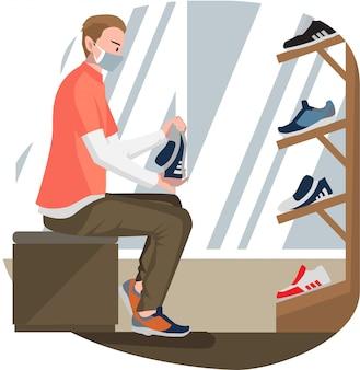 Een man die nieuwe schoenen probeert bij schoenenwinkel