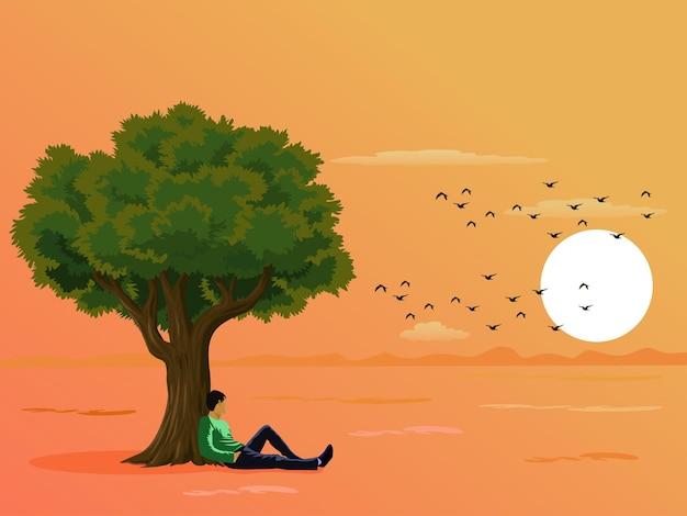 Een man die onder een boom in het veld zit en naar de zonsondergang kijkt met een gele hemelachtergrond