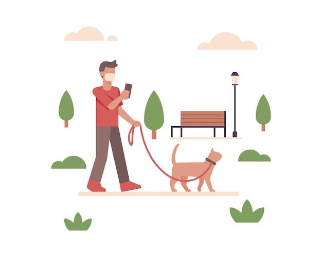 Een man draagt een gezichtsmasker en loopt in het stadspark van de openbare ruimte met zijn schattige kattenillustratie