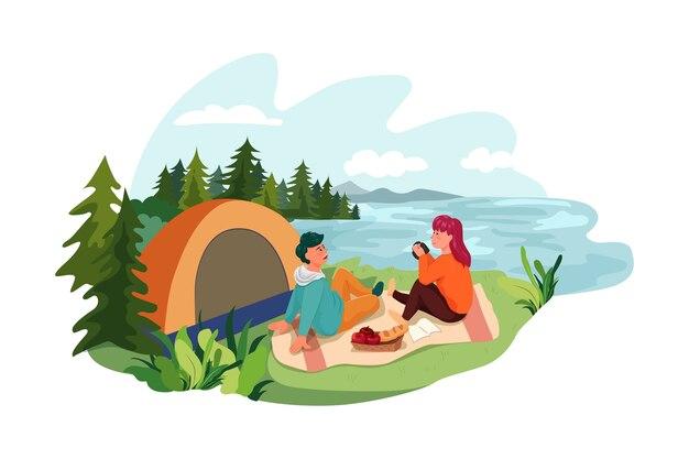 Een man en vrouw die een tent opzetten bij het meer