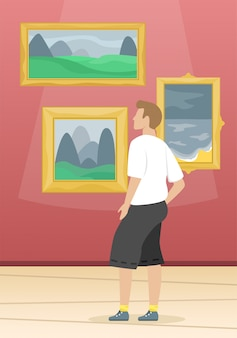 Een man kijkt naar de schilderijen van beroemde kunstenaars. museum voor schone kunsten. klassieke kunst.