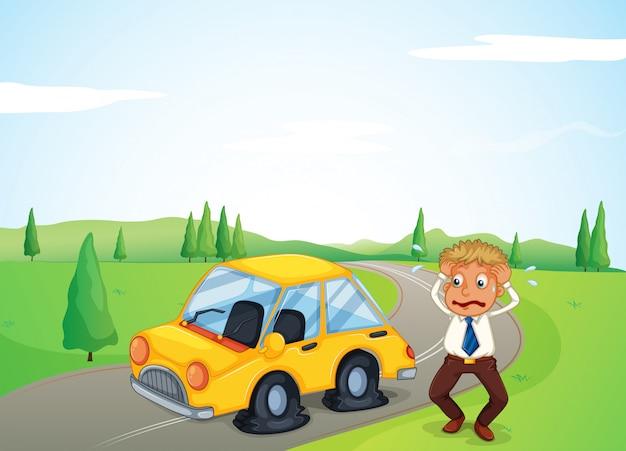Een man naast zijn gele auto met een lekke band