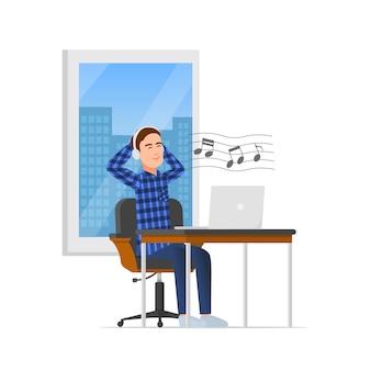 Een man neemt een pauze terwijl hij naar muziek luistert