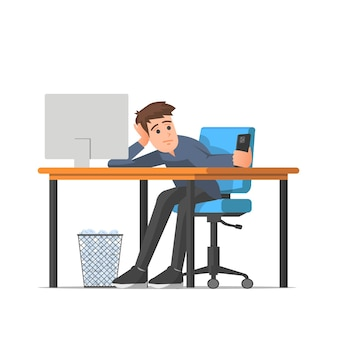 Een man verveelt zich op zijn werk