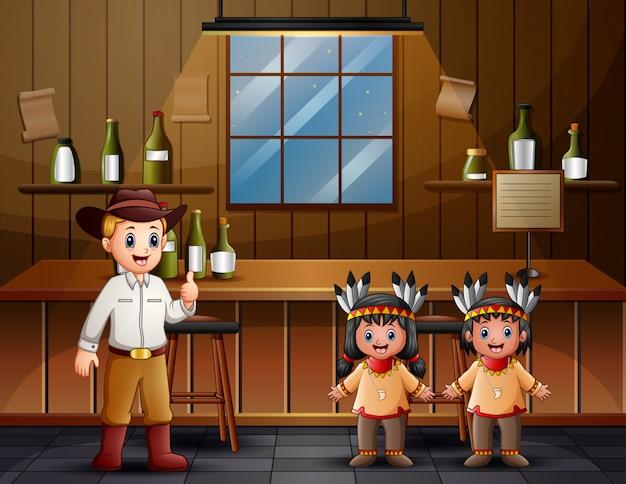 Een mannelijke coboy met indiase jongen aan de bar