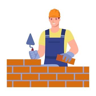 Een mannelijke metselaar in uniform bouwt een muur metselaarsdiensten