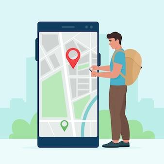 Een mannelijke toerist met een telefoon in zijn handen gebruikt elektronische kaarten om een locatie te vinden. vectorillustratie in vlakke stijl