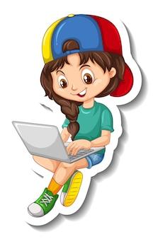 Een meisje dat een sticker van een stripfiguur op een laptop gebruikt