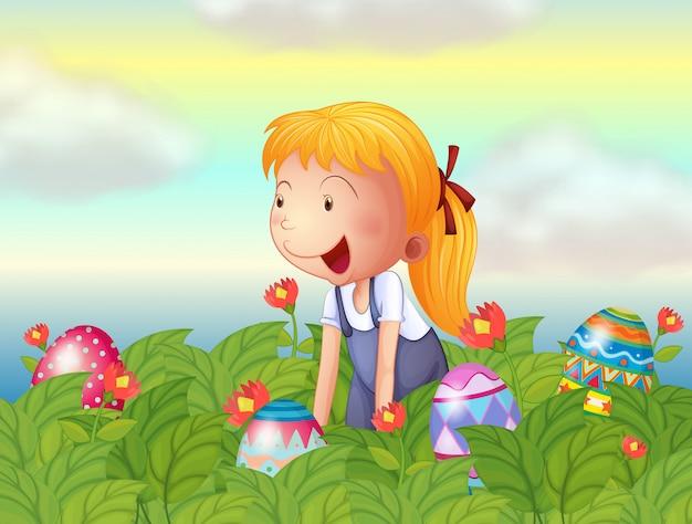 Een meisje dat eieren in de tuin ziet